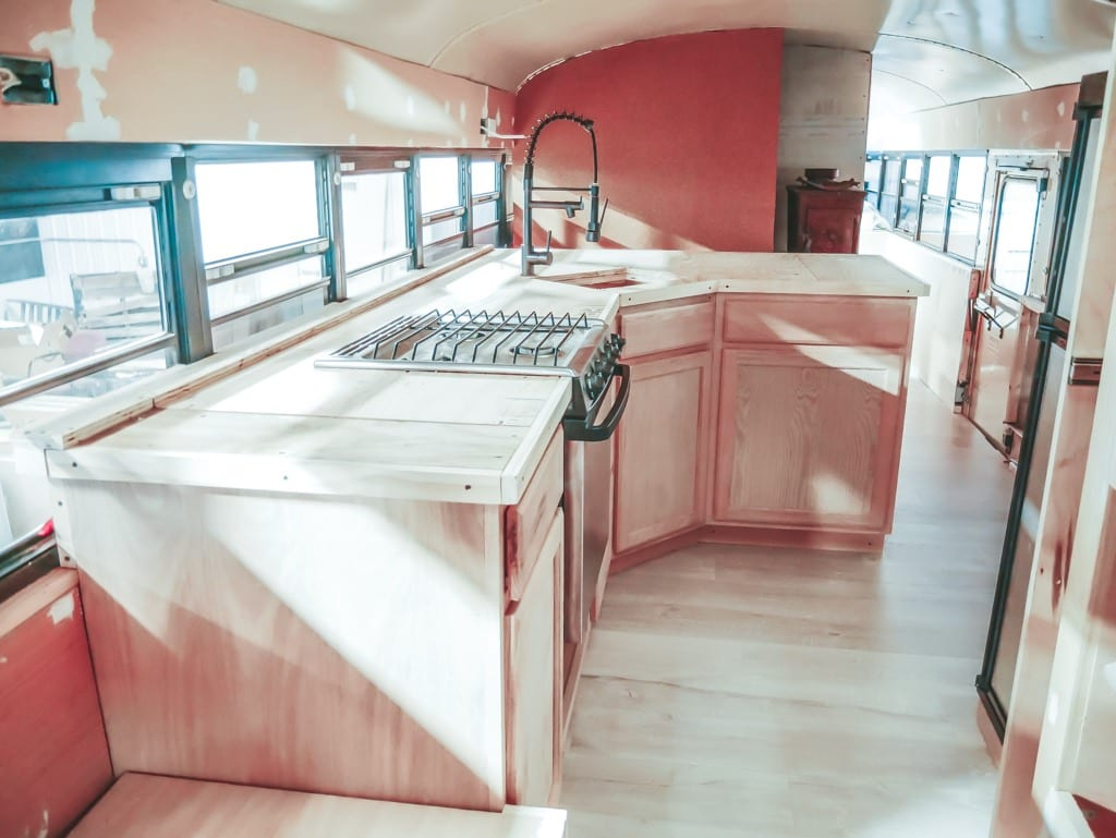We get a lot of questions about our little skoolie kitchen! From our conrete countertops to the rose gold appliances, here are the answers! | Since We Woke Up | sincewewokeup.com