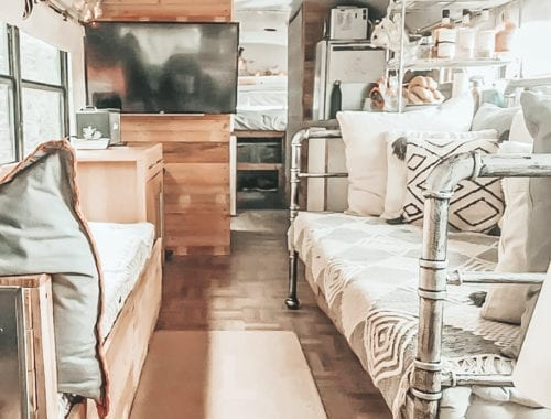 Today we're featuring the Real Buslife of Cheshire, a skoolie named Otto with a full kitchen, parquet floors, and a hanging table! | Since We Woke Up | sincewewokeup.com